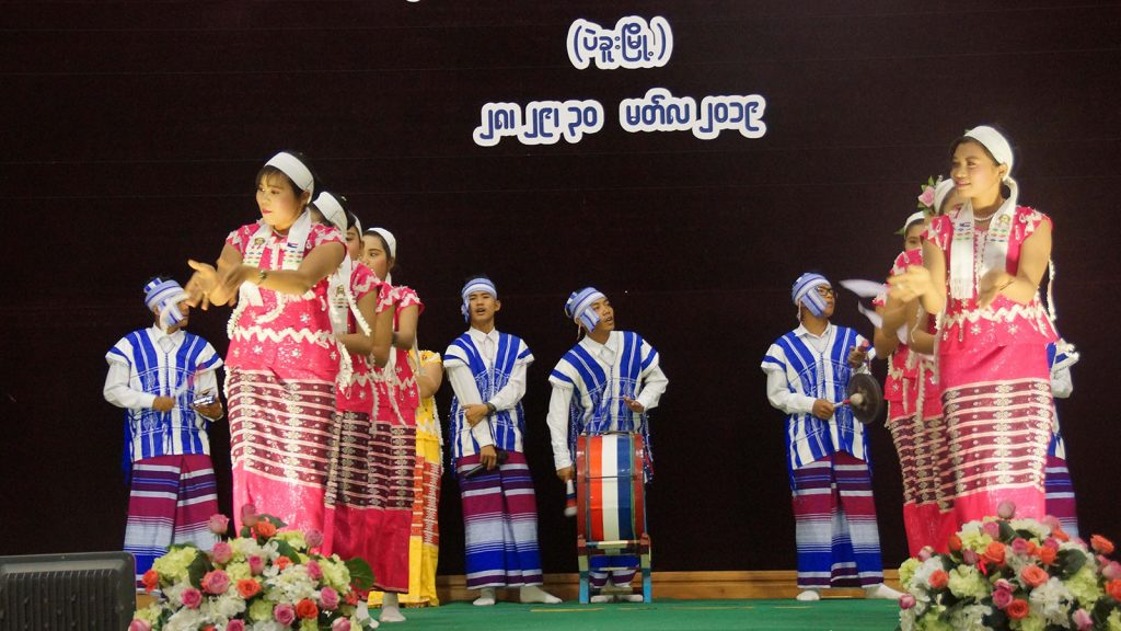 Students entertain the visitors with Kayin traditional dances at the Children's Literary Festival in Bago yesterday.Photo: MNA