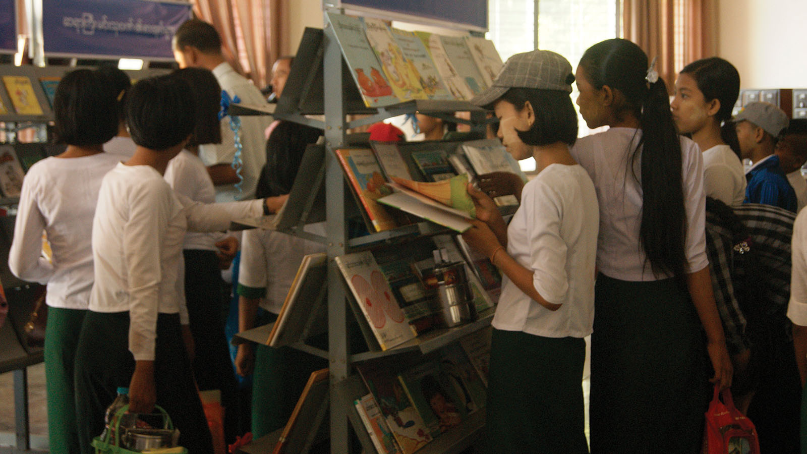 Students read books from the bookstalls at the Children's Literary Festival (Bago) yesterday.Photo: Wai Lyal