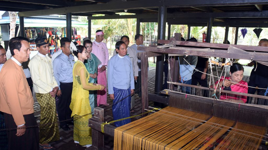 President U Win Myint and party visit the National Races Village in Yangon yesterday.Photo: MNA