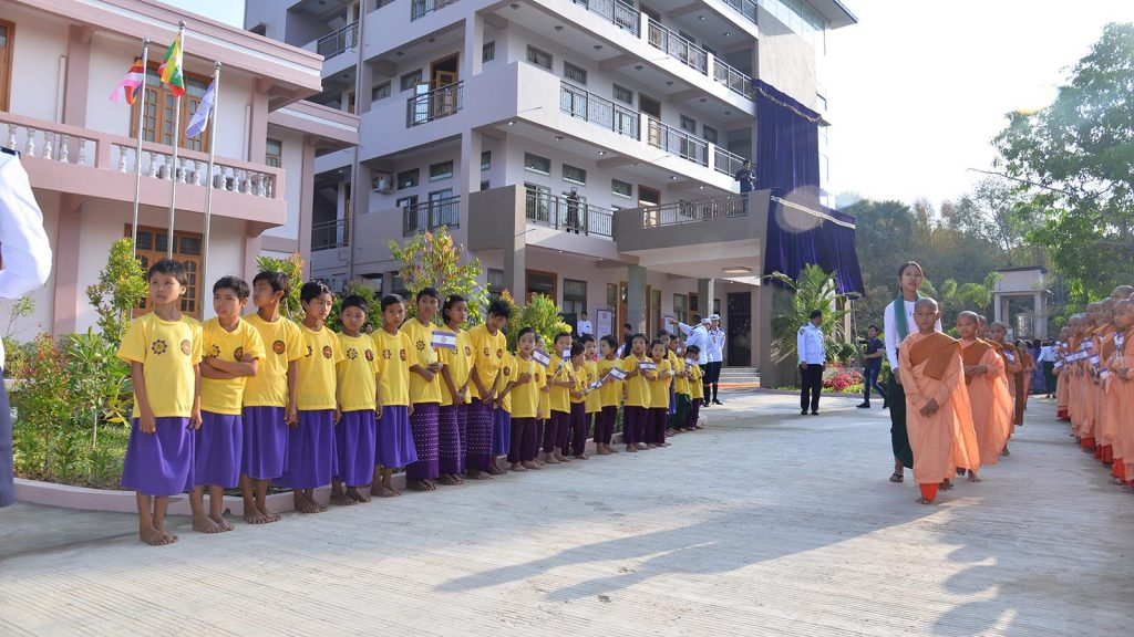 Children and nuns are seen outside Visakha Ponami Gonwei nunnery and the philanthropic building in Lewe. Photo: MNA