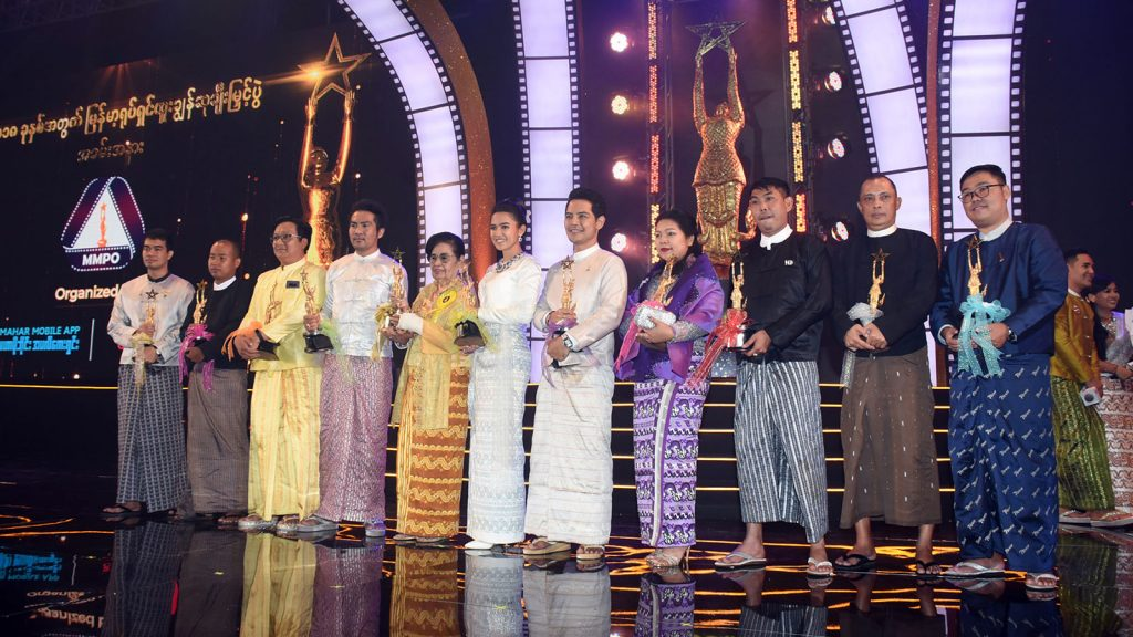 Winners of the Academy Awards for 2018 pose for a group photo at the Myanmar Academy Award Event at the One Entertainment in Yangon yesterday.Photo: MNA