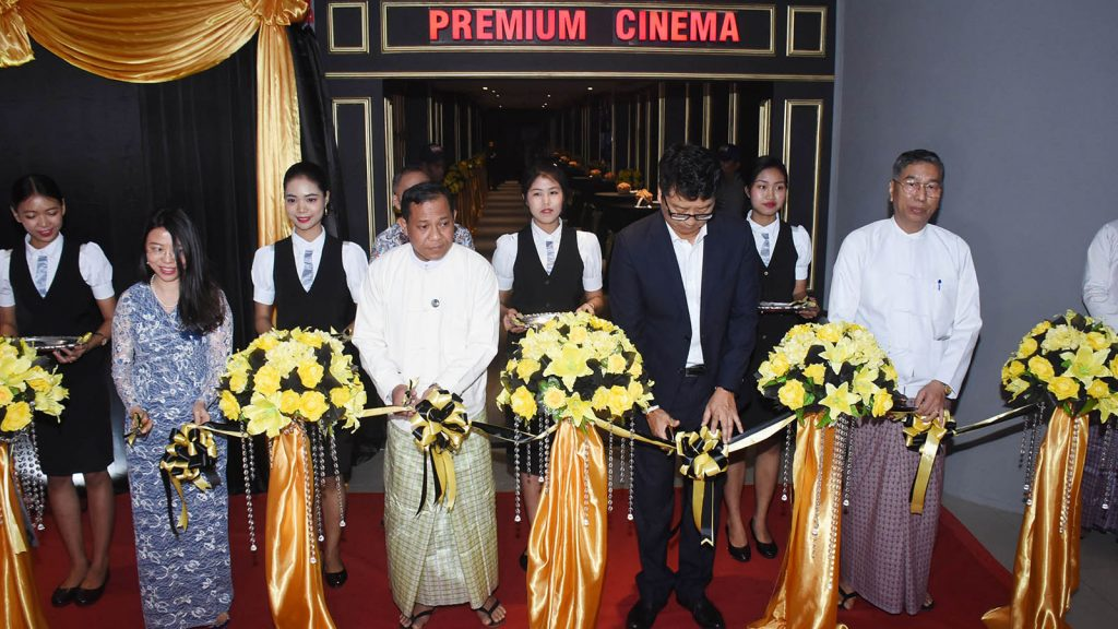 Officials open the first premium cinema of Myanmar at Level-1 of Junction Square shopping center in Yangon yesterday. PHOTO: ZAW MIN LATT