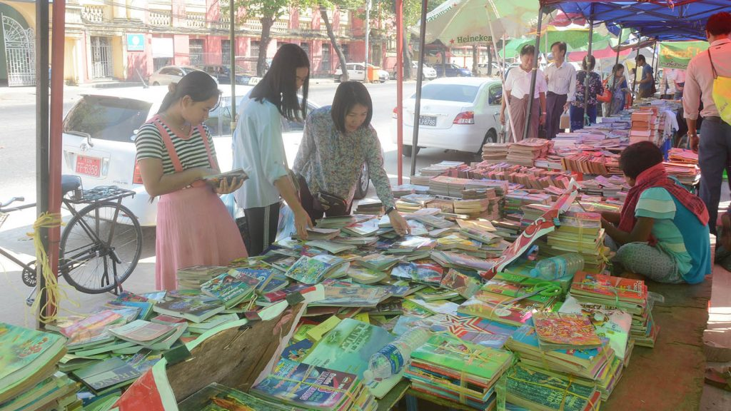 People visit the book street in Yangon yesterday.Photo : Thant Zin Win