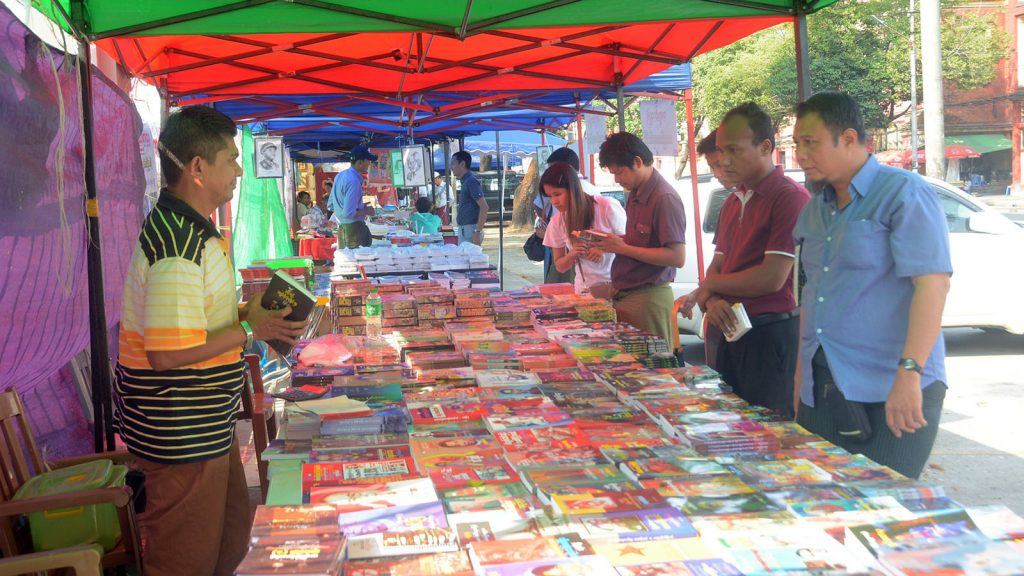Book-lovers buying books at the Yangon Book Street yesterday.Photo : Thant Zin Win
