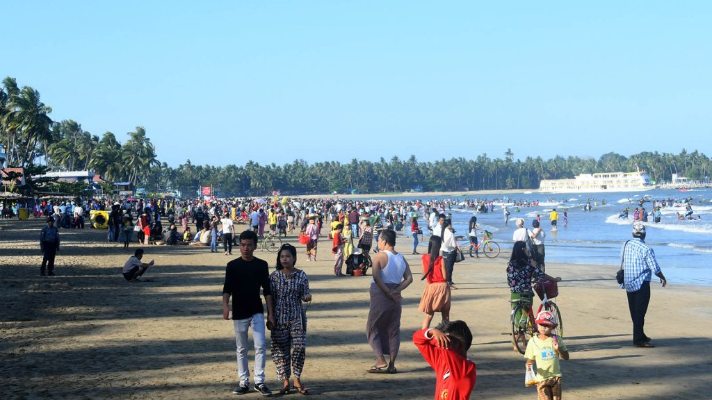 People make their day at the Chaungtha Beach. Photo: MNA