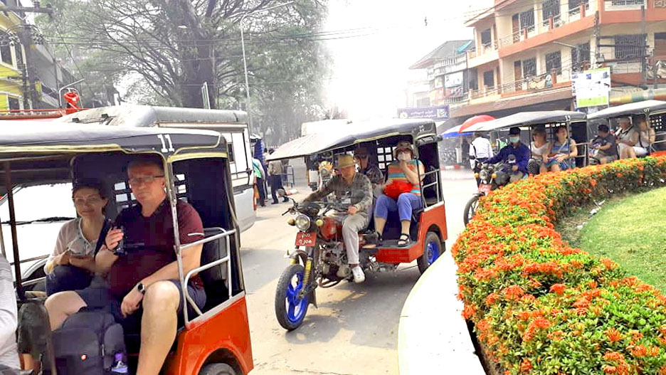 Tourists sightseeing with three wheeled motorcycle in Tachilek.Photo: Supplied