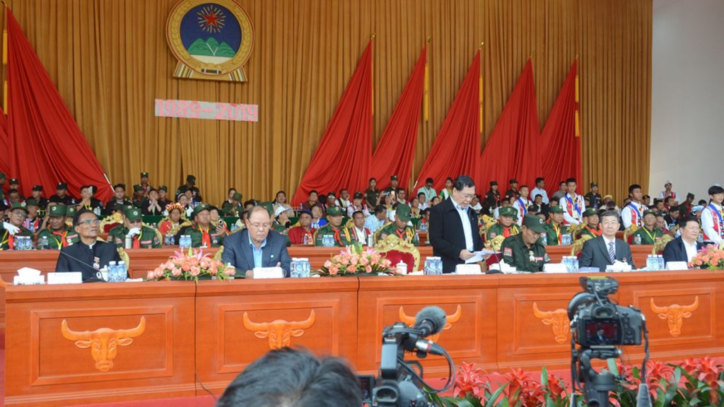 Union Minister U Thein Swe reads a greetings message sent by Daw Aung San Suu Kyi, who is also Chairperson of the National Reconciliation and Peace Centre at the ceremony for the 30th peace building anniversary of Wa Special Region No. 2 in Pangsang yesterday.Photo: MNA