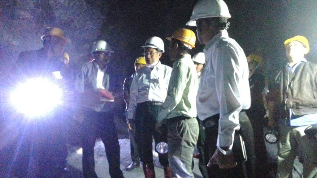 Union Minister U Ohn Win inspects the inside of the antimony mines project in Hopone Township in sourthern Shan State. Photo: MNA