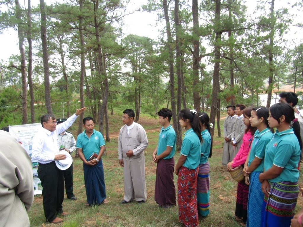Union Minister U Ohn Win meets with locals while inspecting REDD+ project plantation in Pwayhla village in Pintaya on 13 May 2018. Photo: MNA