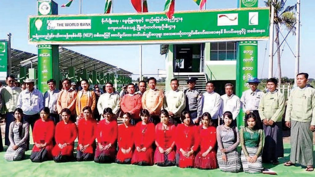Bago Region Chief Minister U Win Thein and officials pose for a group photo at a ceremony to mark the initiation of electricity by using the  micro solar system at Thatit Chun Village on 22 December, 2018.Photo: MNA