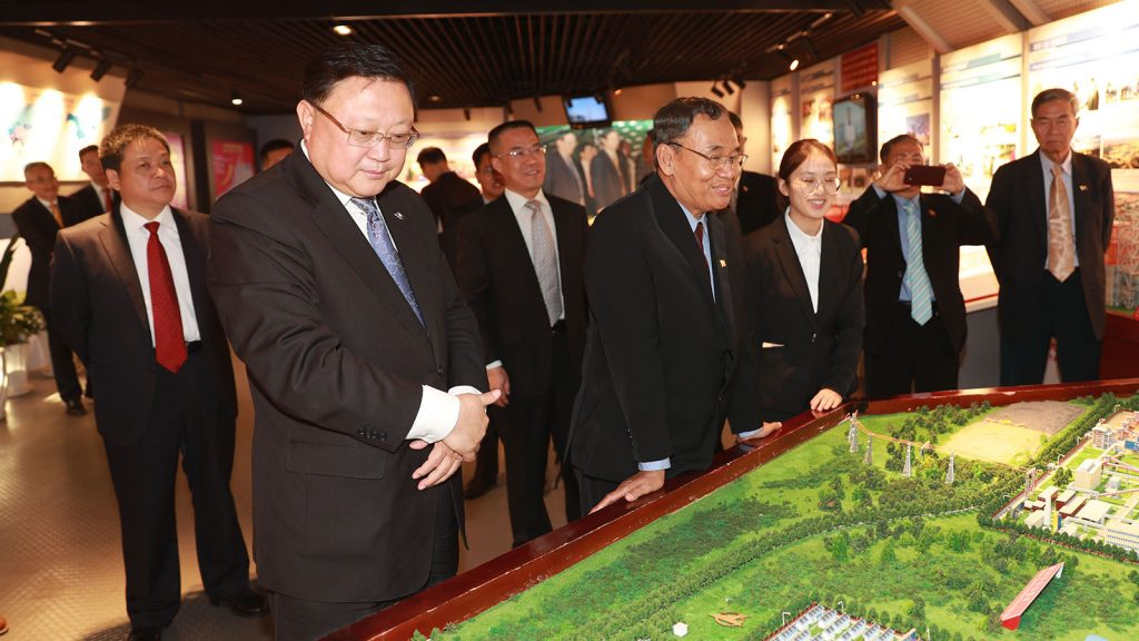 Union Minister U Ohn Win visits the exhibition at Norinco Company in Beijing. Photo: MNA