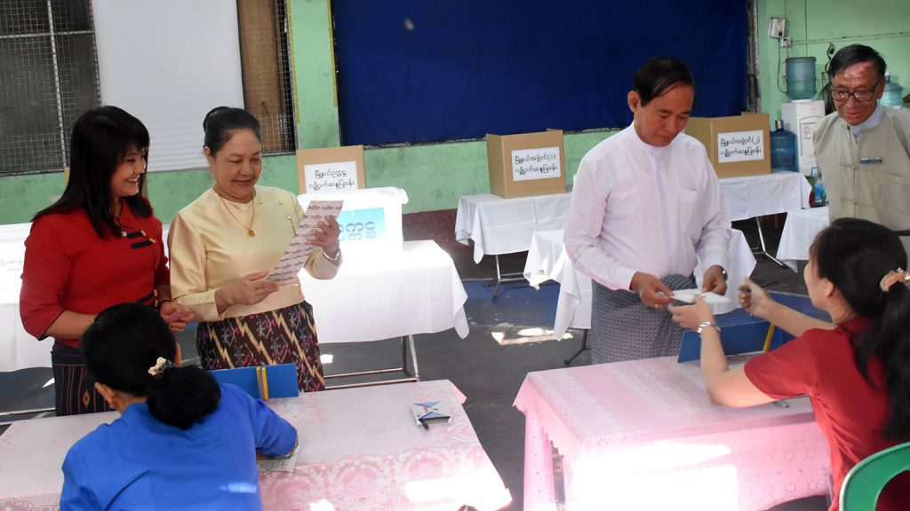 President U Win Myin (Right), First Lady Daw Cho Cho (Middle) and their daughter (Left) cast their votes in the Yangon City Development Committee elections at the No. 3 Constituency, Kyarkwatthit Ward, Tamway Township in Yangon yesterday.Photo: MNA