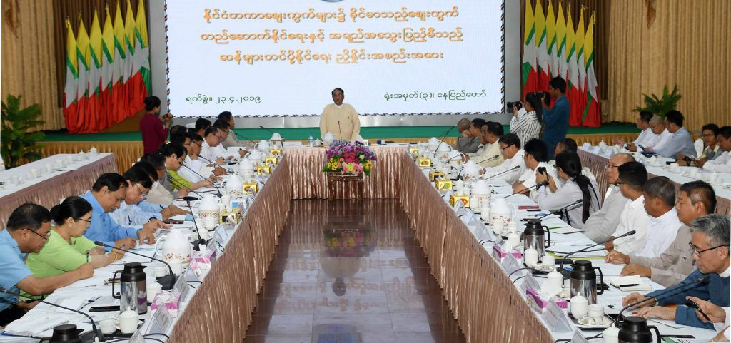 Union Minister Dr. Than Myint delivers the speech at the coordination meeting on establishing a firm international market and to export quality rice in Nay Pyi Taw yesterday. Photo: MNA