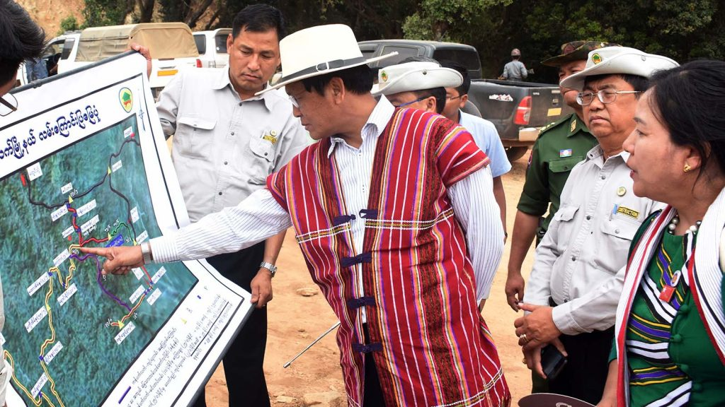 Vice President U Hnery Van Thio views the map showing the strategic road between Kanpetlet and Paletwa.Photo: MNA