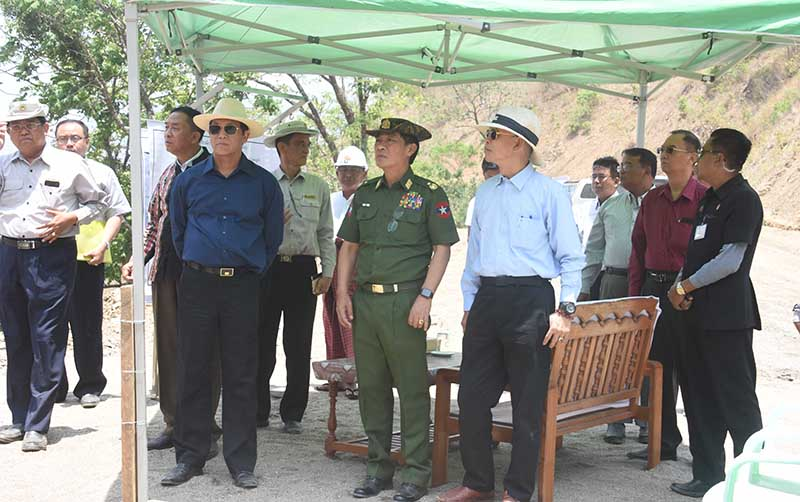 Vice President U Henry Van Thio and officials inspect work on the expansion of the Matupi-Haka Road in Chin State yesterday.Photo : MNA