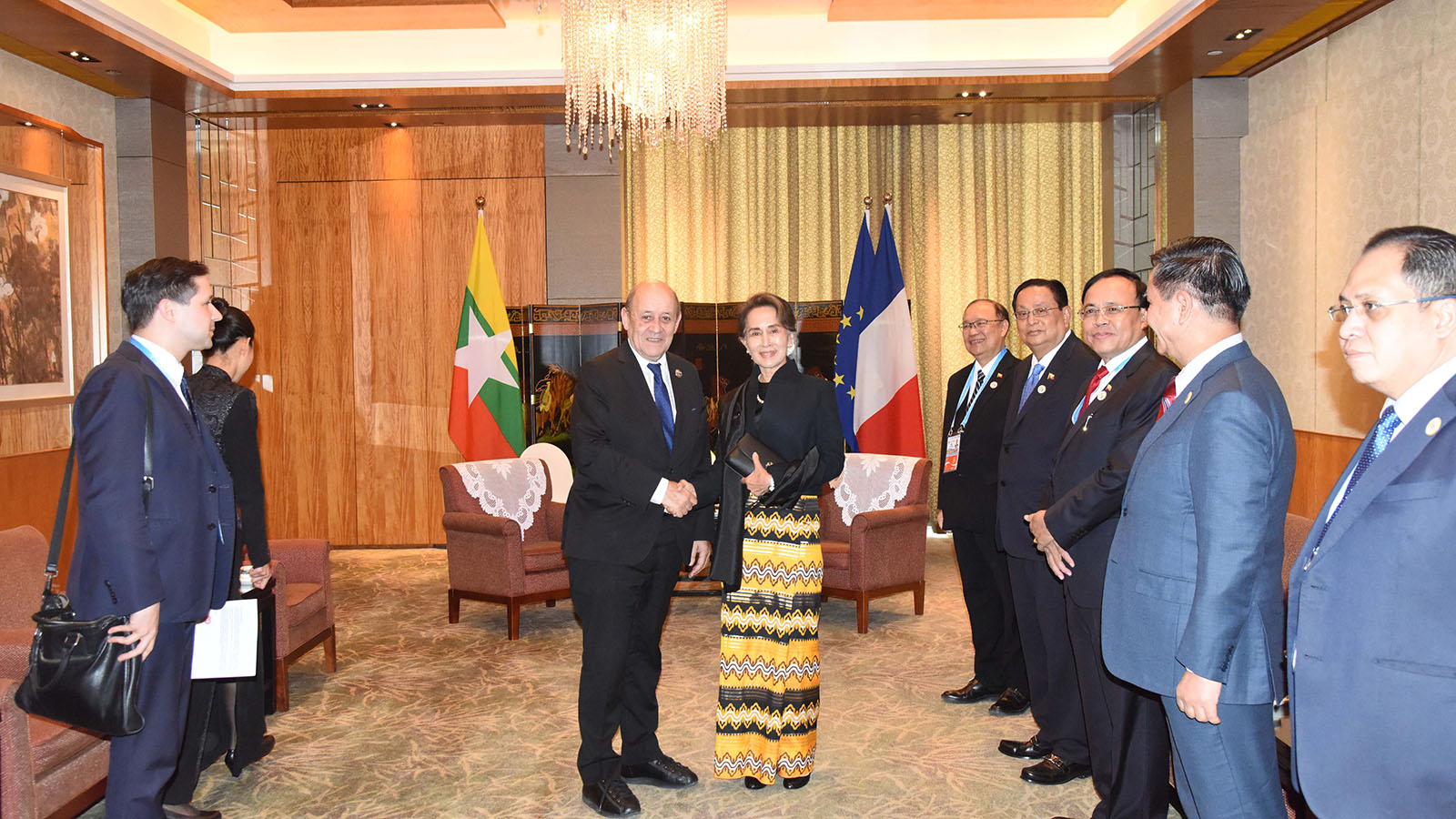 State Counsellor Daw Aung San Suu Kyi shakes hands with the French Minister for Europe and Foreign Affairs, Mr. Jean-Yves Le Drian, while attending the Belt and Road forum in China. photo: mna