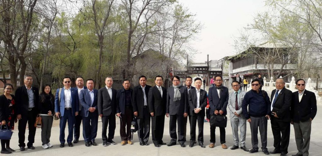 The Myanmar delegation led by Union Minister Dr. Pe Myint pose for a documentary photo together with Chinese officials at the State Production Base of the China Film Group in Beijing.Photo: MNA