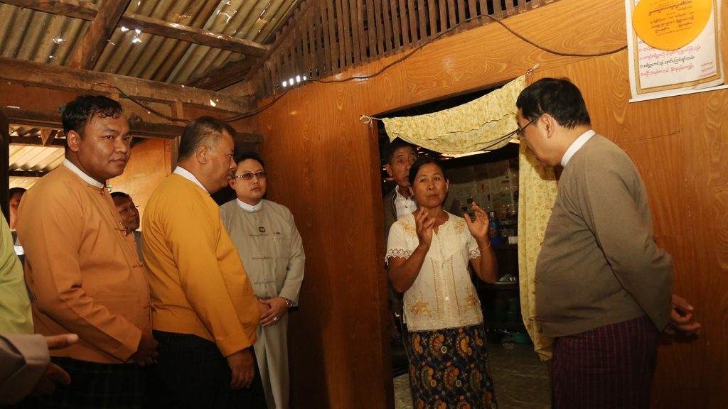 Union Minister Dr. Win Myat Aye encourages victims of hailstorm in Ywangan, Shan State.Photo: MNA