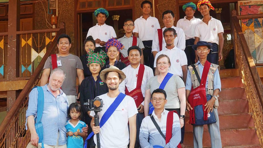 Finland Red Cross Society team pose for a photo with villagers in Loikaw Township yesterday. Photo: MNA