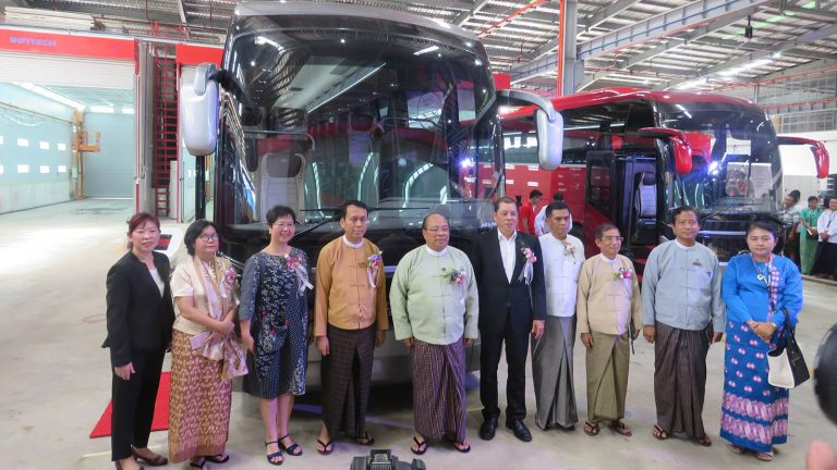 Union Minister U Thaung Tun, Yangon Region Chief Minister U Phyo Min Thein and attendees pose for a photograph at the opening ceremony of the SC Auto (Myanmar) Factory in Yangon yesterday.Photo: MNA