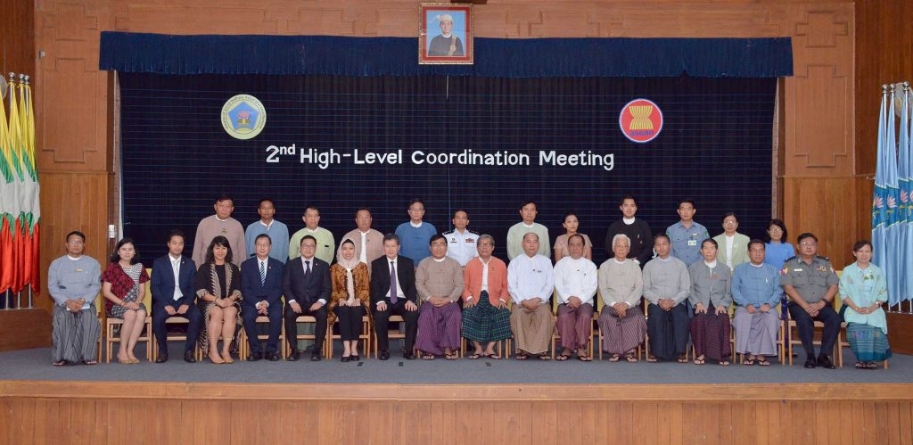 Union Minister Dr. Win  Myat Aye and attendees pose for a photo at the 2nd High Level coordination meeting at Ministry of Social Welfare, Relief and Resettlement in Nay Pyi Taw yesterday.Photo: MNA