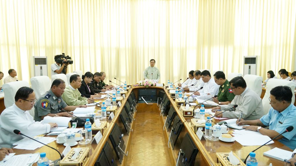 Union Minister for Labour, Immigration and Population U Thein Swe addresses the High Level Working Group-HLWG Committee's coordination meeting in Nay Pyi Taw yesterday.Photo: MNA