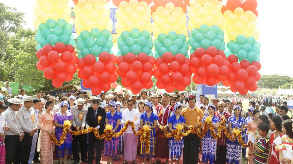 Amyotha Hluttaw Speaker Mahn Win Khaing Than, Union Minister U Han Zaw and officials open the new inter-village tar road in Kyonbyaw Township, Ayeyawady Region yesterday.Photo: MNA