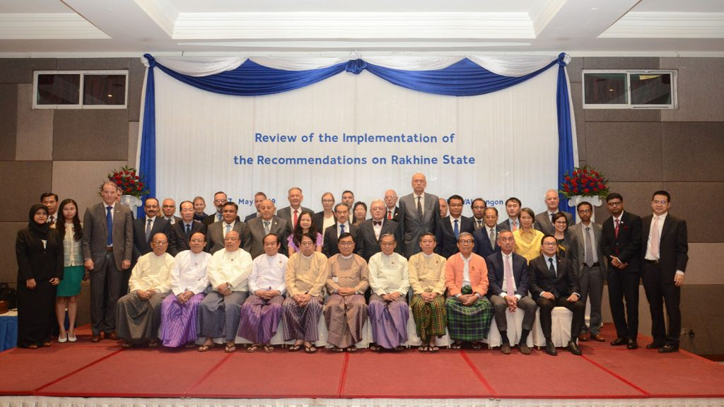 Union Ministers U Kyaw Tint Swe, Dr. Pe Myint, Dr. Myo Thein Gyi, Dr. Myint Htwe, U Thaung Tun, Dr. Win Myat Aye, U Kyaw Tin and attendees pose for the documentary photo at the workshop on Review of the Implementation of the Recommendations on Rakhine State in Yangon yesterday. Photo: Phoe Khwar