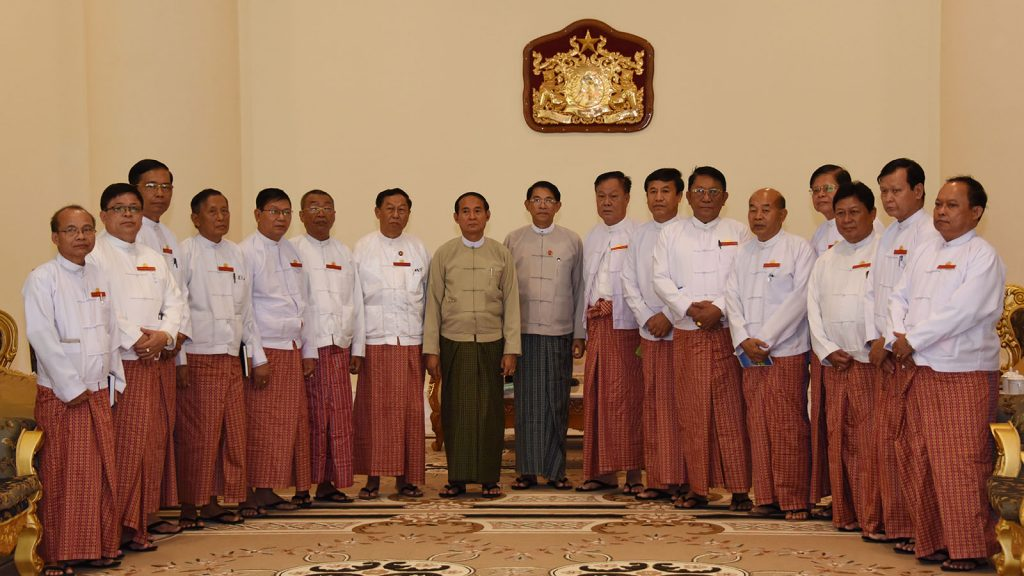 President U Win Myint poses for a photo together with Union Election Commission Chairman U Hla Thein and UEC members yesterday. Photo: MNA