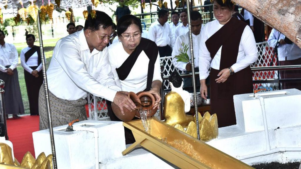 Senior General Min Aung Hlaing and wife Daw Kyu Kyu Hla pouring water on the Bodhi tree at the Lawkachantha Hsutaungpyae Pagoda in Zeyathiri Township in Nay Pyi Taw on the full moon day of Kason, yesterday. Photo : Office of the Commander-in-Chief of Defence Services