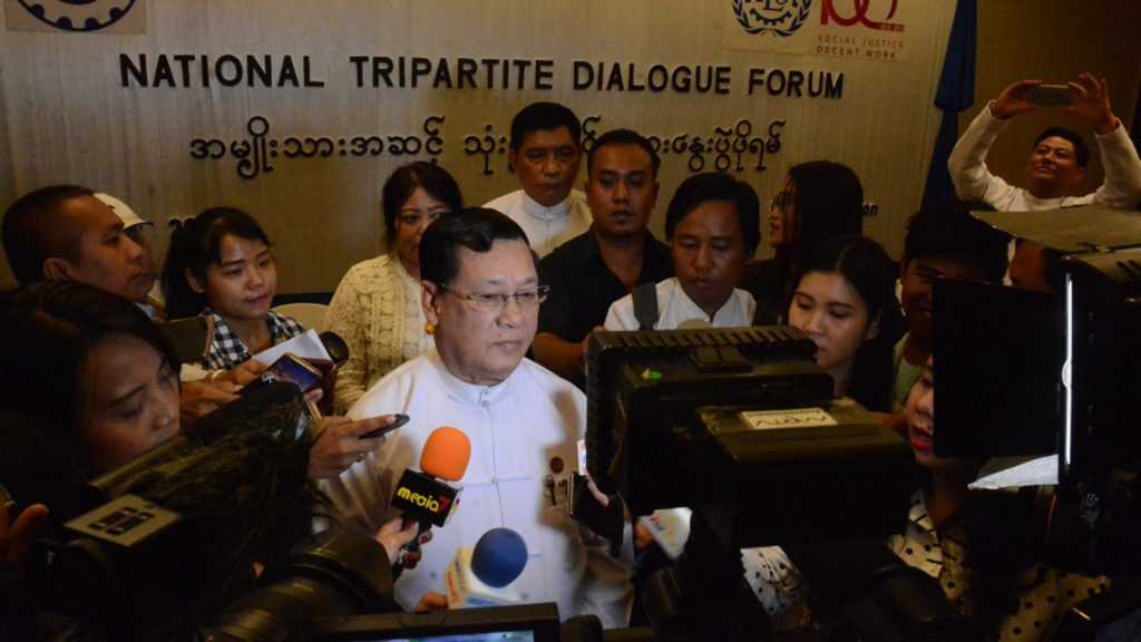 Union Minister U Thein Swe meets with journalists at National Tripartite Dialogue Forum in Yangon. yesterday. Photo : Phoe Htaung