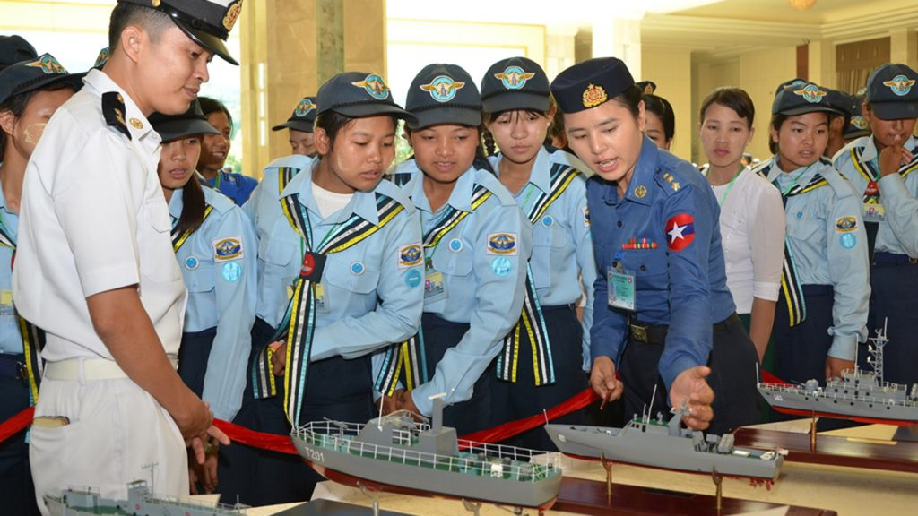 Maritime and aviation youths observe scale models of warships produced by the Tatmadaw (Navy) displayed at the Zeyarthiri Beikman in Nay Pyi Taw.Photo: Office of the C-IN-C of defence services