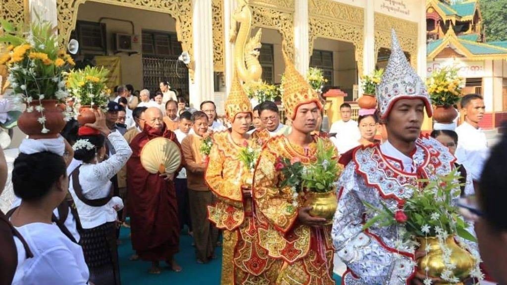 People clad in ceremonial dress as they take part in the Buddha Day celebrations in Mandalay yesterday. Photo :MNA