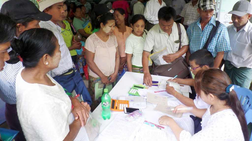 Local farmers in Thanlyin Township gather at the Thanlyin Township Agricultural Development Bank to get loans for planting rice in rain-fed fields.Photo: Kyaw Zeya