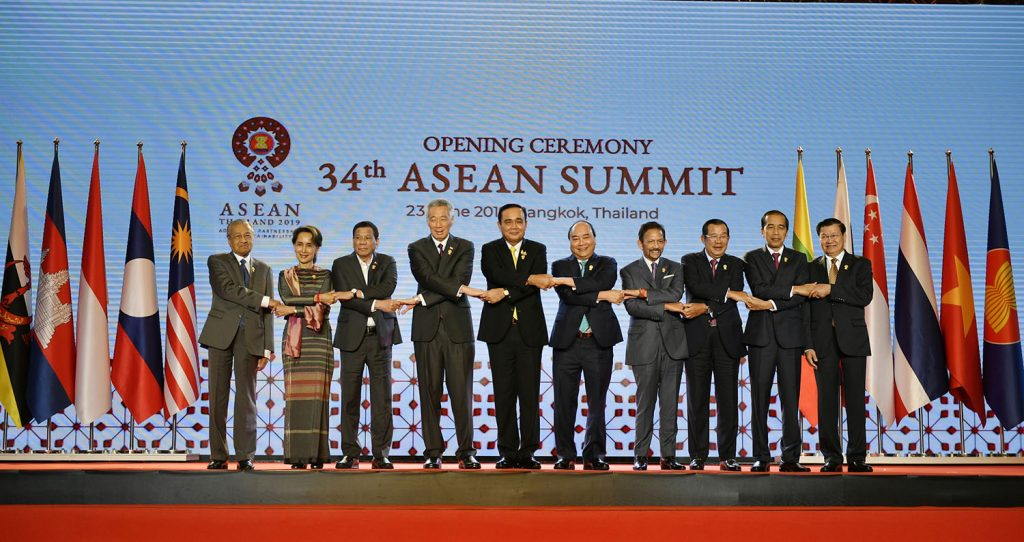 State Counsellor Daw Aung San Suu Kyi poses for a group photo at the opening ceremony of the 34th ASEAN Summit in Bangkok, Thailand yesterday. Photo: MNA