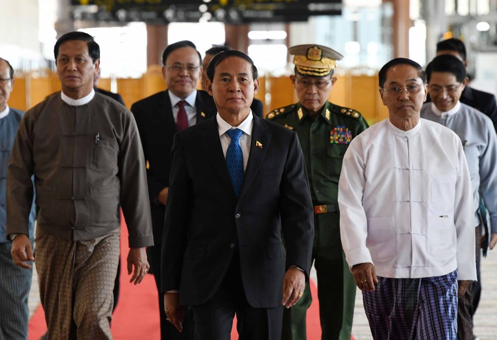 President U Win Myint (Center) being welcomed by Vice Presidents U Myint Swe and U Henry Van Thio (Left),  Deputy Commander-in-Chief of Defence Services Vice-Senior General Soe Win and Union Minister U Min Thu at the Nay Pyi Taw International Airport as he arrives back from New Delhi, India yesterday.  Photo: MNA
