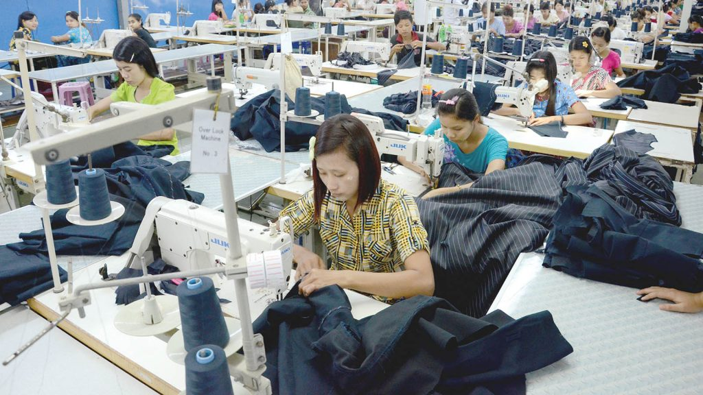 Workers are sewing in a garment factory in Hlinethaya Industrial Zone. PHOTO: PHOE KHWAR