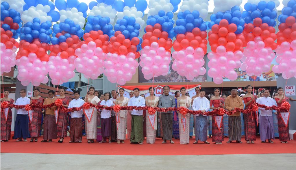 Yangon Region Minister for Rakhine Ethnic Affairs U Zaw Aye Maung and officials open the new Mingalar Cinema in Yangon yesterday.Phtot : Ye Htut