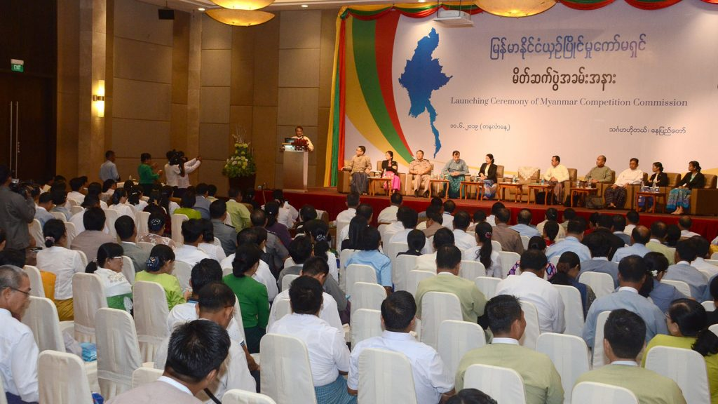 Union Minister Dr. Than Myint delivers the opening speech at the ceremony to launch the Myanmar Competition Commission in Nay Pyi Taw yesterday. Photo: MNA