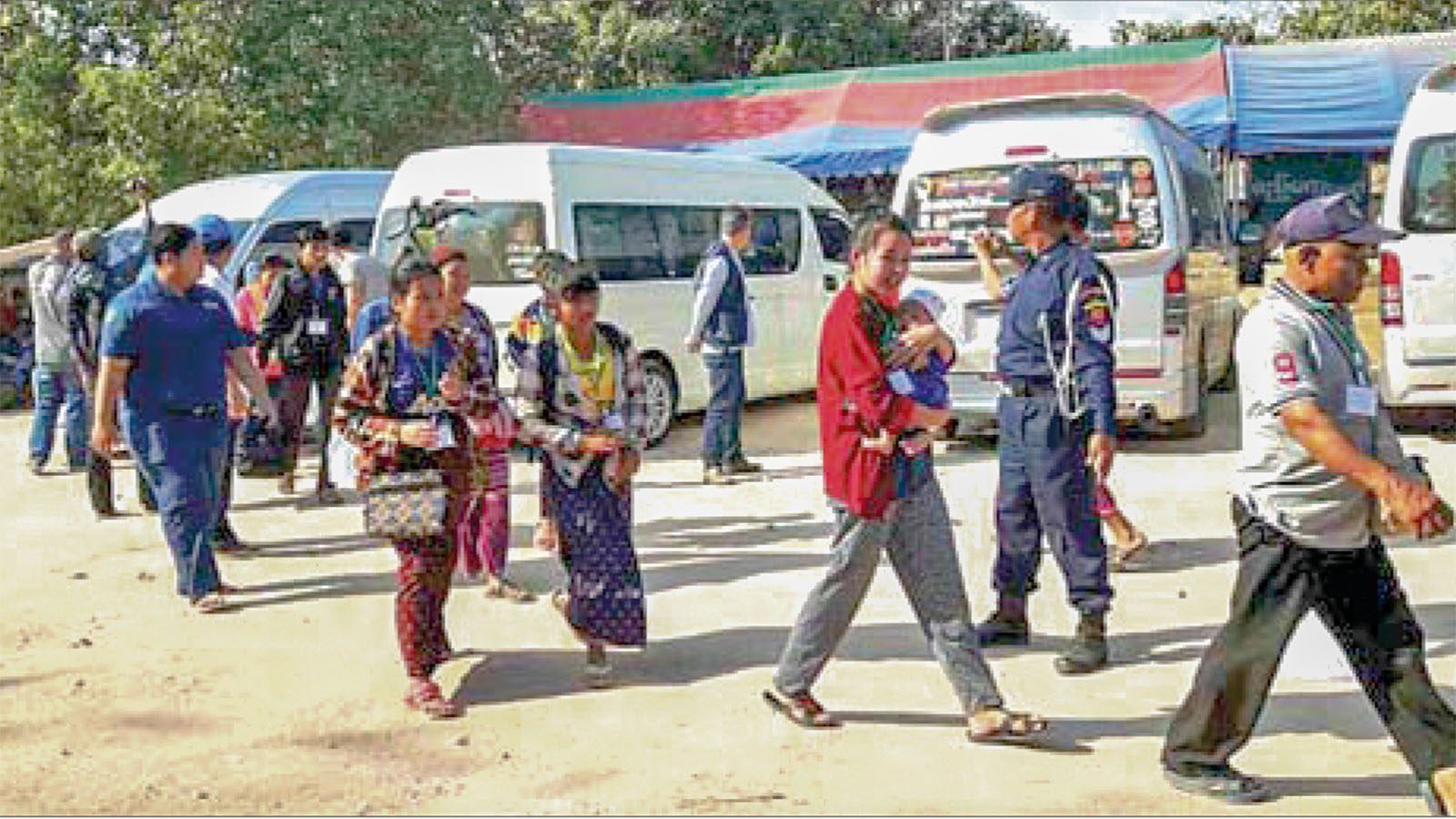 Returnees are warmly welcomed by Myanmar officials.