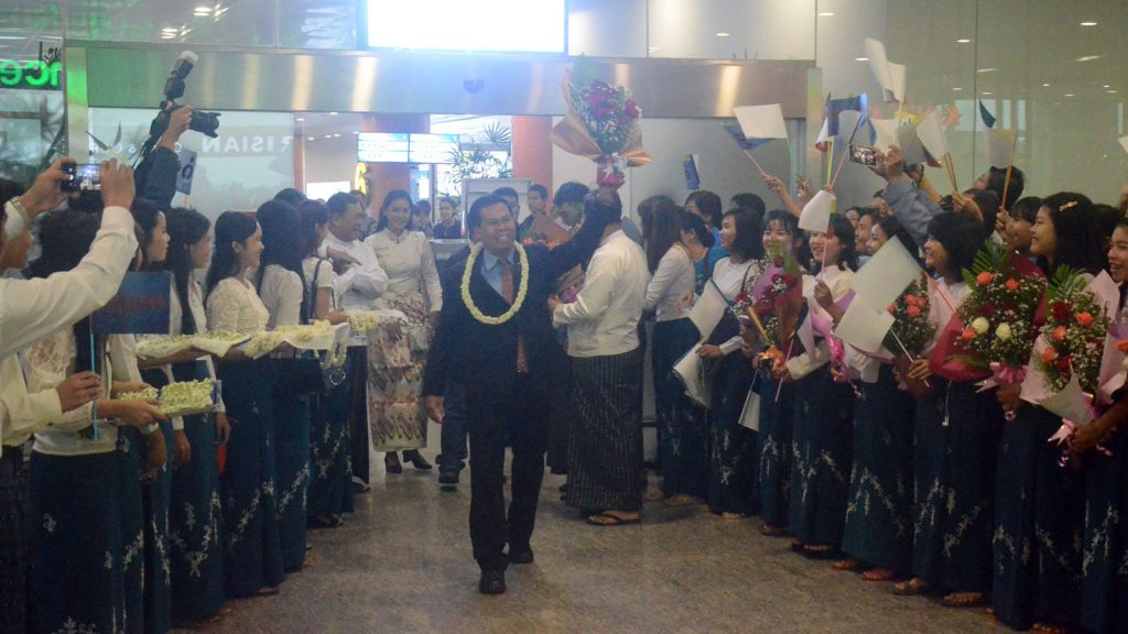 Myanmar delegation arrive back after attending the 43rd session of UNESCO World Heritage Committee at Yangon International Airport yesterday.Photo: MNA