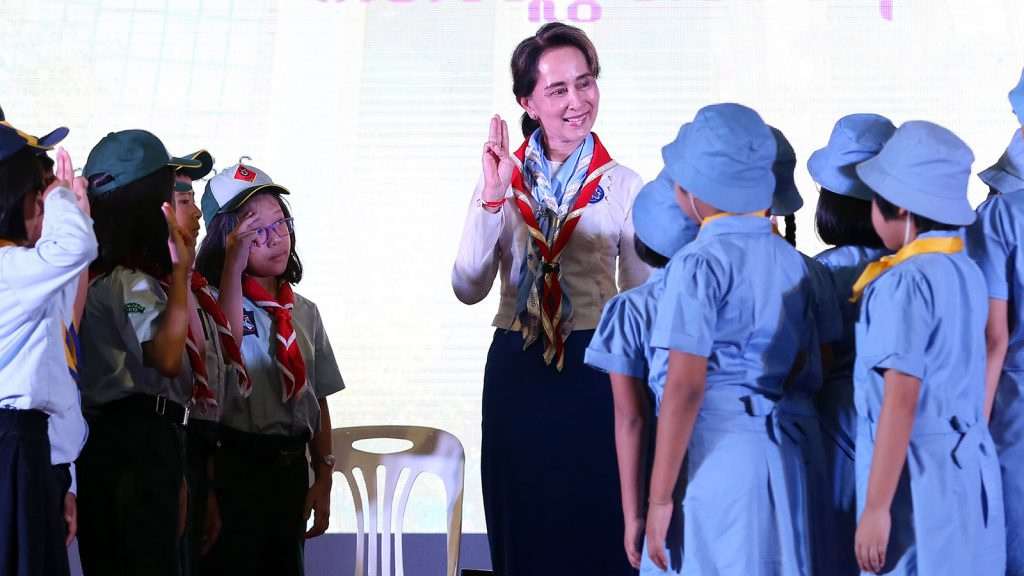 Youth scouts give a three-finger salute to Myanmar Scout Federation Head State Counsellor Daw Aung San Suu Kyi at the Yangon University Diamond Jubilee Hall yesterday. Photo: Thet Aung