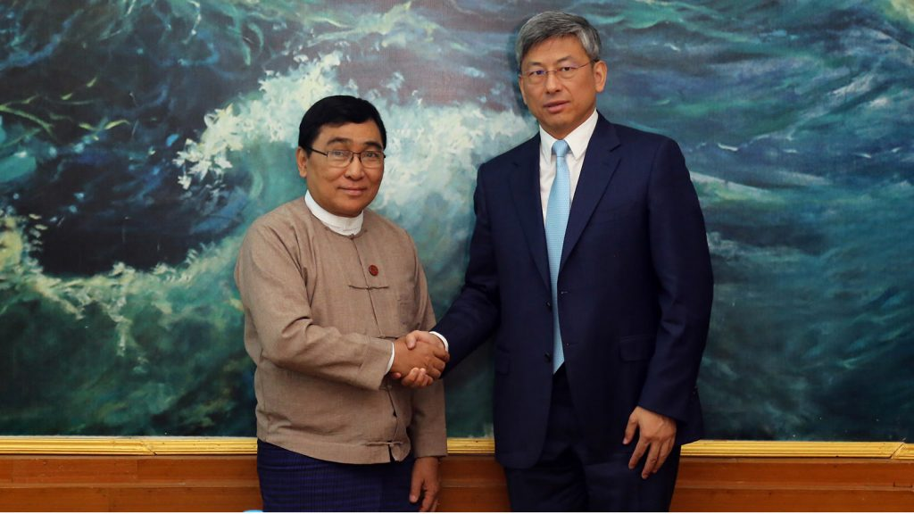Union Minister Dr Win Myat Aye shakes hands with Chinese Ambassador Mr Chen Hai in Nay Pyi Taw yesterday.Photo: MNA