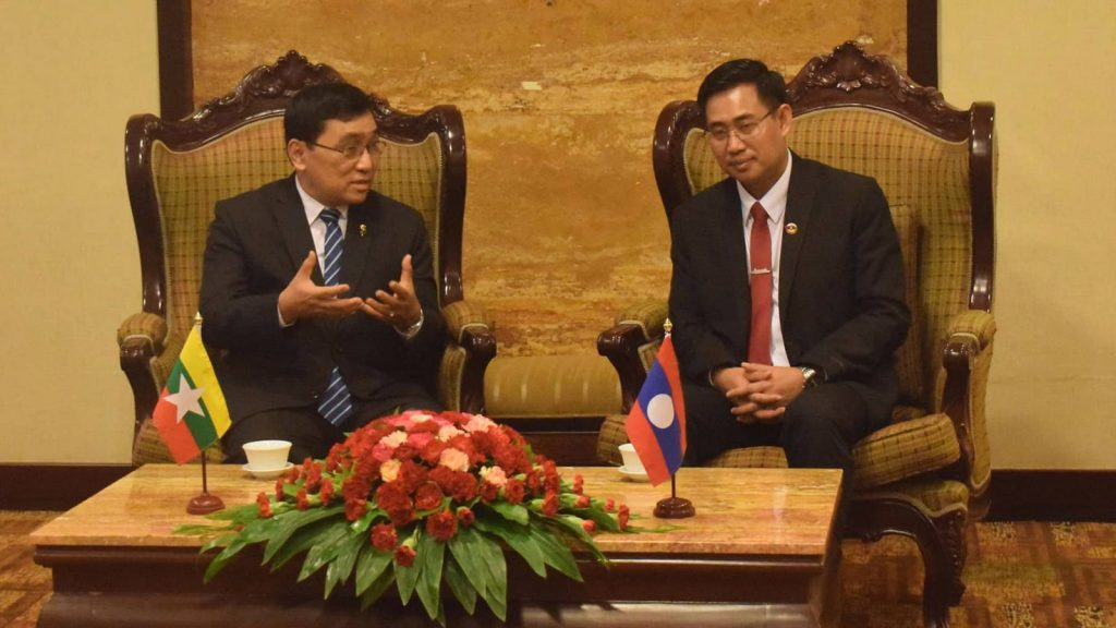 Union Minister Dr Win Myat Aye meets with Secretary General of Lao Youth Union Mr Alounxay Sounnalath in Vientiane yesterday. Photo: mna