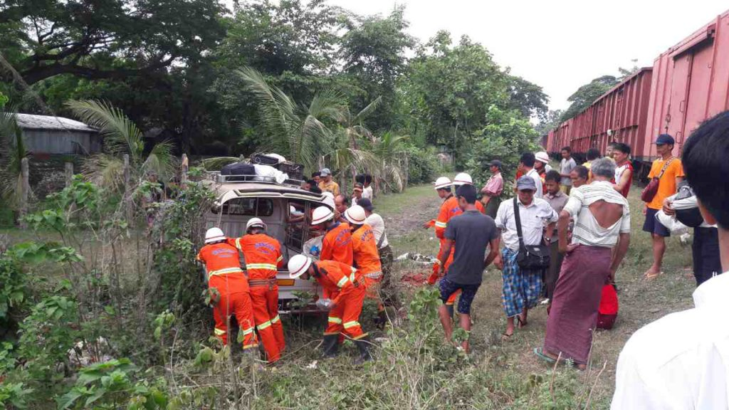 Firemen and volunteers remove the car which was crashed by the train in Kantbalu. Photo: Aung Win Nyein (Kantbalu)