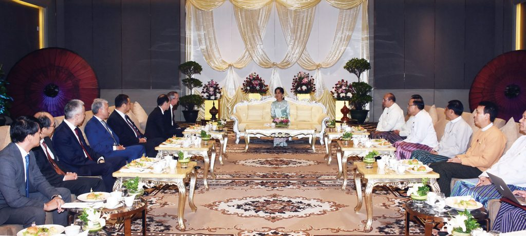 State Counsellor Daw Aung San Suu Kyi meeting with ambassadors, representatives of the respective embassies from Japan and the US at the Myanmar-Japan-US Forum in Yangon yesterday.Photo: MNA
