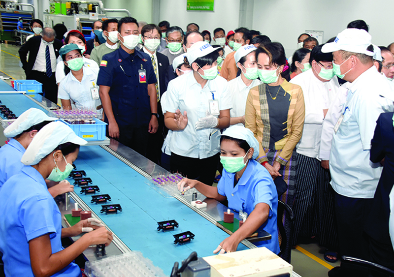 State Counsellor Daw Aung San Suu Kyi visits the production line of the Foster Electric Thilawa Co Ltd in Thilawa SEZ-A .Photo: MNA