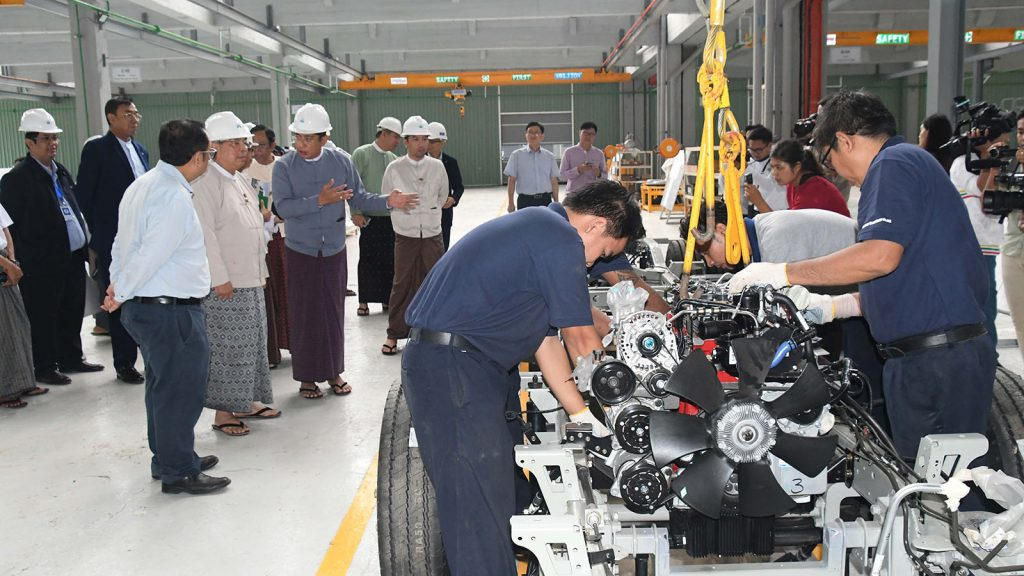 Union Minister U Thaung Tun observes assembling a car on assembly line in Daewoo Bus Myanmar Factory in Mingaladon Township, Yangon.Photo: MNA
