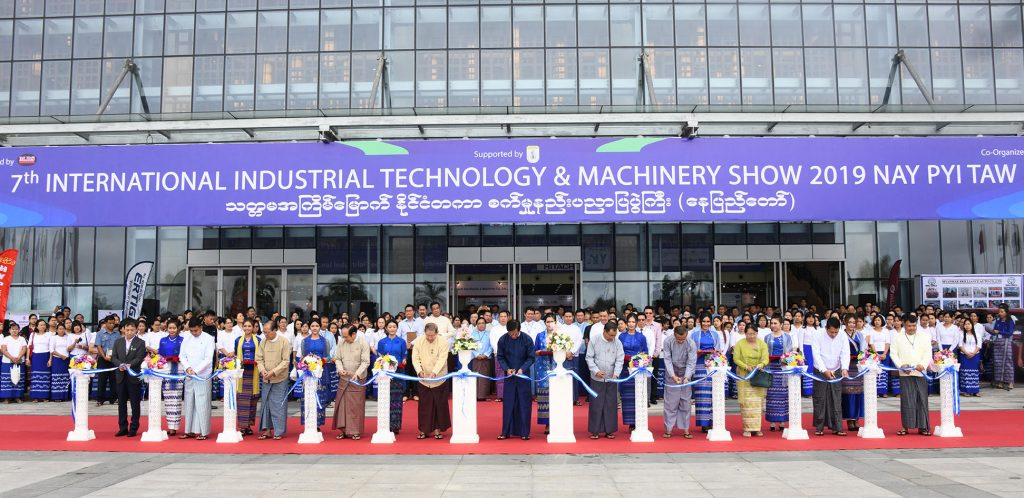 """Vice President U Henry Van Thio and dignitaries cut ribbon to open the 7th Int'l Industrial Technology & Machinery Show"""" 2019 in Nay Pyi Taw yesterday. Photo: MNA"""