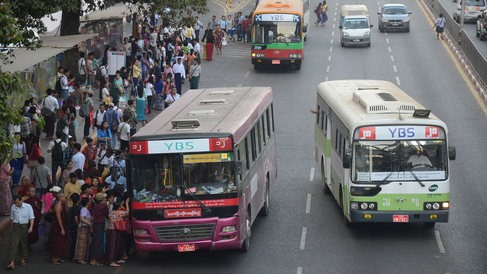 YBS provides commuter bus service that shuttles public between downtown Yangon and its suburb. Photo : Phoe Khwar